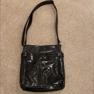 Faux leather black purse with silver accents